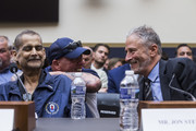 Former Daily show host Jon Stewart, right speaks to Retired New York Police Department detective and 9/11 responder Luis Alvarez , front left, and FealGood Foundation co-founder John Feal, back left, during a House Judiciary Committee hearing on reauthorization of the September 11th Victim Compensation Fund on Capitol Hill on June 11, 2019 in Washington, DC.