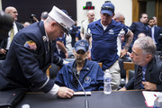 Retired Fire Department of New York Lieutenant and 9/11 responder Michael O'Connell, left FealGood Foundation co-founder John Feal, center right, and Former Daily Show Host Jon Stewart, right speak to Retired New York Police Department detective and 9/11 responder Luis Alvarez during a House Judiciary Committee hearing on reauthorization of the September 11th Victim Compensation Fund on Capitol Hill on June 11, 2019 in Washington, DC. The fund provides financial assistance to responders, victims and their families who require medical care related to health issues they suffered in the aftermath of 9/11 terrorist attacks.