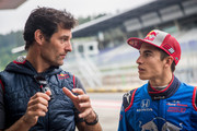 Mark Webber of Australia (L) gives instructions to Marc Marquez of Spain (R) prior the F1 testing on June 5, 2018 in Spielberg, Austria.
