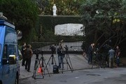 News media wait outside the Playboy Mansion home of Hugh Hefner, who was the founder of Playboy Magazine, in Beverly Hills, California on September 28, 2017. .Hugh Hefner, the silk pajama-wearing founder of Playboy who helped escort nudity into the American mainstream, died Wednesday, the company announced. He was 91 years old..Hefner, father of the trailblazing brand that encouraged a loosening of sexual strictures, died of natural causes in his Los Angeles home -- the famed Playboy Mansion -- according to a statement from Playboy Enterprises.. / AFP PHOTO / Mark RALSTON