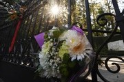 Flowers left by fans on September 28, 2017 at the main gate outside the Playboy Mansion home of Hugh Hefner, who died the previous day, in Beverly Hills, California. .The iconic Playboy Magazine was founded six decades ago by Hefner, who died on September 27 at the age of 91... / AFP PHOTO / Mark RALSTON