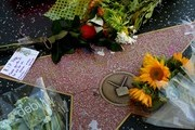 Flowers placed by fans are seen on the Hollywood Walk of Fame star belonging to the Playboy Magazine founder Hugh Hefner, after he died aged 91, in Hollywood, California on September 28, 2017.  / AFP PHOTO / Mark RALSTON