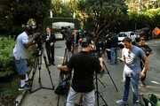 News media report on September 28, 2017 from the main gate outside the Playboy Mansion home of Hugh Hefner, who died the previous day, in Beverly Hills, California. .The iconic Playboy Magazine was founded six decades ago by Hefner, who died on September 27 at the age of 91... / AFP PHOTO / Mark RALSTON