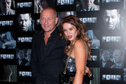 (R-L)  Kierston Wareing and Sean Pertwee attend the UK premiere of 'Four' at The Empire Cinema on October 10, 2011 in London, England.