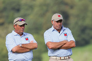 USA Team caddies Jimmy Johnson (L) and Steve Williams wait on a green during the rescheduled Afternoon Foursome Matches during the 2010 Ryder Cup at the Celtic Manor Resort on October 2, 2010 in Newport, Wales.