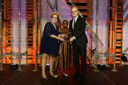 (L-R) Caryl M. Stern, CEO & President of UNICEF USA, and Joyce Chisale present the 2018 UNICEF Children's Champion Award to Lawrence O'Donnell  onstage during the Fourteenth Annual UNICEF Gala Boston 2018 on May 23, 2018 in Boston, Massachusetts.