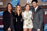 "(L-R) Musician Keith Urban, Dana Walden, Co-Chairman/CEO, Fox Television Group, singer/actress Jennifer Lopez and musician Harry Connick Jr. arrive at Fox TV's ""American Idol XIV"" finalist party at The District on March 11, 2015 in Los Angeles, California."