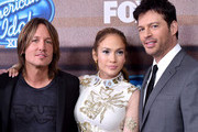 "(L-R) Musician Keith Urban, singer/actress Jennifer Lopez and musician Harry Connick Jr. arrive at Fox TV's ""American Idol XIV"" finalist party at The District on March 11, 2015 in Los Angeles, California."
