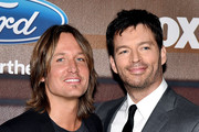 """Musicians Keith Urban (L) and Harry Connick Jr. arrive at Fox TV's """"American Idol XIV"""" finalist party at The District on March 11, 2015 in Los Angeles, California."""