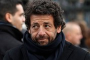 French singer Patrick Bruel leaves the La Madeleine Church at the end of the funeral ceremony in tribute to late French singer Johnny Hallyday on December 9, 2017 in Paris. .French music icon Johnny Hallyday died on December 6, 2017 aged 74 after a battle with lung cancer, plunging the country into mourning for a national treasure whose soft rock lit up the lives of three generations.  / AFP PHOTO / POOL / YOAN VALAT
