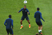 Patrice Evra of France heads the ball during a training session ahead the UEFA EURO 2016 Group A match between France and Albania at Stade Velodrome on June 14, 2016 in Marseille, France.