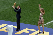 Former German International Footballer, Philipp Lahm and Philanthropist, Natalia Vodianova present the 2018 FIFA World Cup Original Trophy ahead of the 2018 FIFA World Cup Final between France and Croatia at Luzhniki Stadium on July 15, 2018 in Moscow, Russia.