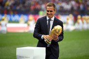Former German International Footballer, Philipp Lahm presents the 2018 FIFA World Cup Original Trophy ahead of the 2018 FIFA World Cup Final between France and Croatia at Luzhniki Stadium on July 15, 2018 in Moscow, Russia.