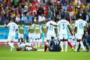 Paul Pogba of France and Wilson Palacios of Honduras lie on the floor after a challenge during the 2014 FIFA World Cup Brazil Group E match between France and Honduras at Estadio Beira-Rio on June 15, 2014 in Porto Alegre, Brazil.