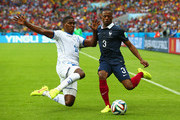 Brayan Beckeles of Honduras challenges Patrice Evra of France during the 2014 FIFA World Cup Brazil Group E match between France and Honduras at Estadio Beira-Rio on June 15, 2014 in Porto Alegre, Brazil.