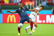 Patrice Evra of France and Andy Najar of Honduras  battle for the ball during the 2014 FIFA World Cup Brazil Group E match between France and Honduras at Estadio Beira-Rio on June 15, 2014 in Porto Alegre, Brazil.