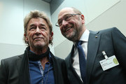 Martin Schulz (R), chancellor candidate of the German Social Democrats (SPD) in German federal elections scheduled for September, chats with German rock singer Peter Maffay at a meeting of the SPD Bundestag faction prior to the election of the new president of Germany by the Federal Assembly at the Reichstag on February 12, 2017 in Berlin, Germany. Frank-Walter Steinmeier, a German Social Democrat (SPD), is Germany's former foreign minister and is likely to win. He will succeed outgoing German president Joachim Gauck.