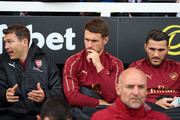 Aaron Ramsey of Arsenal sits on the bench during the Premier League match between Fulham FC and Arsenal FC at Craven Cottage on October 7, 2018 in London, United Kingdom.