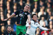 Aaron Wilbraham of Bristol City (L) beats Scott Parker of Fulham to a header during the Sky Bet Championship match between Fulham and Bristol City at Craven Cottage on March 12, 2016 in London, United Kingdom.