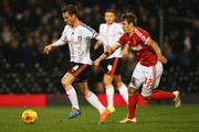 Scott Parker of Fulham is chased by Robert Tesche of Nottingham Forest during the Sky Bet Championship match between Fulham and Nottingham Forest at Craven Cottage on January 21, 2015 in London, England.