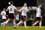 Ross McCormack of Fulham (C) celebrates with Scott Parker (8) as he scores their first and equalising goal during the Sky Bet Championship match between Fulham and Rotherham United at Craven Cottage on April 15, 2015 in London, England.