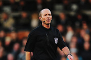 Match referee Mike Dean is seen during the Barclays Premier League match between Fulham and Sunderland at Craven Cottage on January 11, 2014 in London, England.