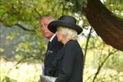 """CHATSWORTH, ENGLAND, OCTOBER 2: Prince Charles, Prince of Wales, and Camilla, Duchess of Cornwall make their way to the burial plot following the funeral of Deborah, Dowager Duchess of Devonshire at St Peter's Church, Edensor on October 2, 2014 in Chatsworth, England. Deborah Cavendish, Dowager Duchess Of Devonshire, the last surviving Mitford sister, died aged 94 on September 24, 2014. Deborah was known as the """"housewife duchess"""", and her noted business acumen made Chatsworth House one of the most successful and profitable stately homes in England."""