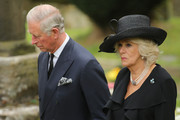 """Prince Charles, Prince of Wales and Camilla, The Duchess of Cornwall, attend the funeral of Deborah, Dowager Duchess of Devonshire makes its way to St Peters Church, Edensor, past Chatsworth House on October 2, 2014 in Chatsworth, England. Deborah Cavendish, Dowager Duchess Of Devonshire, the last surviving Mitford sister, died aged 94 on September 24, 2014. Deborah was known as the """"housewife duchess"""", and her noted business acumen made Chatsworth House one of the most successful and profitable stately homes in England."""