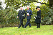 """CHATSWORTH, ENGLAND, OCTOBER 2: Prince Charles, Prince of Wales, and Camilla, Duchess of Cornwall (R) walk alongside the The Duke of Devonshire (L) following the funeral of Deborah, Dowager Duchess of Devonshire at St Peter's Church, Edensor, on October 2, 2014 in Chatsworth, England. Deborah Cavendish, Dowager Duchess Of Devonshire, the last surviving Mitford sister, died aged 94 on September 24, 2014. Deborah was known as the """"housewife duchess"""", and her noted business acumen made Chatsworth House one of the most successful and profitable stately homes in England."""