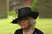 """Camilla, Duchess of Cornwall attends the funeral of Deborah, Dowager Duchess of Devonshire at St Peters Church, Edensor on October 2, 2014 in Chatsworth, England. Deborah Cavendish, Dowager Duchess Of Devonshire, the last surviving Mitford sister, died aged 94 on September 24, 2014. Deborah was known as the """"housewife duchess"""", and her noted business acumen made Chatsworth House one of the most successful and profitable stately homes in England."""