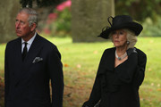 """Prince Charles, Prince of Wales and Camilla, The Duchess of Cornwall,  attend the funeral of Deborah, Dowager Duchess of Devonshire at St Peters Church, Edensor, on October 2, 2014 in Chatsworth, England. Deborah Cavendish, Dowager Duchess Of Devonshire, the last surviving Mitford sister, died aged 94 on September 24, 2014. Deborah was known as the """"housewife duchess"""", and her noted business acumen made Chatsworth House one of the most successful and profitable stately homes in England."""