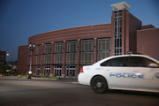 A police car passes in front of the Friendly Temple Missionary Baptist Church as they prepare for the funeral service of Michael Brown on August 25, 2014 in St. Louis, Missouri. Michael Brown was shot and killed by a police officer in the nearby town of Ferguson, Missouri on August 9. His death caused several days of violent protests along with rioting and looting in Ferguson