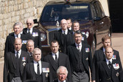 Prince Charles, Prince of Wales, Princess Anne, Princess Royal, Prince Andrew, Duke of York, Prince Edward, Earl of Wessex, Prince William, Duke of Cambridge, Peter Phillips, Prince Harry, Duke of Sussex, Earl of Snowdon David Armstrong-Jones and Vice-Admiral Sir Timothy Laurence follow Prince Philip, Duke of Edinburgh's coffin as it arrives at St George's Chapel during the funeral of Prince Philip, Duke of Edinburgh at Windsor Castle on April 17, 2021 in Windsor, United Kingdom. Prince Philip of Greece and Denmark was born 10 June 1921, in Greece. He served in the British Royal Navy and fought in WWII. He married the then Princess Elizabeth on 20 November 1947 and was created Duke of Edinburgh, Earl of Merioneth, and Baron Greenwich by King VI. He served as Prince Consort to Queen Elizabeth II until his death on April 9 2021, months short of his 100th birthday. His funeral takes place today at Windsor Castle with only 30 guests invited due to Coronavirus pandemic restrictions.