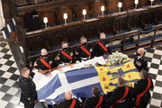 Queen Elizabeth II (left) watches as pall bearers place the coffin of the Duke of Edinburgh during his funeral in St George's Chapel at Windsor Castle on April 17, 2021 in Windsor, England. Prince Philip of Greece and Denmark was born 10 June 1921, in Greece. He served in the British Royal Navy and fought in WWII. He married the then Princess Elizabeth on 20 November 1947 and was created Duke of Edinburgh, Earl of Merioneth, and Baron Greenwich by King VI. He served as Prince Consort to Queen Elizabeth II until his death on April 9 2021, months short of his 100th birthday. His funeral takes place today at Windsor Castle with only 30 guests invited due to Coronavirus pandemic restrictions.