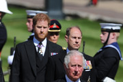 Prince Charles, Prince of Wales and other royal family members walk behind The Duke of Edinburgh's coffin, covered with His Royal Highness's Personal Standard, during the Ceremonial Procession during the funeral of Prince Philip, Duke of Edinburgh at Windsor Castle on April 17, 2021 in Windsor, England. Prince Philip of Greece and Denmark was born 10 June 1921, in Greece. He served in the British Royal Navy and fought in WWII. He married the then Princess Elizabeth on 20 November 1947 and was created Duke of Edinburgh, Earl of Merioneth, and Baron Greenwich by King VI. He served as Prince Consort to Queen Elizabeth II until his death on April 9 2021, months short of his 100th birthday. His funeral takes place today at Windsor Castle with only 30 guests invited due to Coronavirus pandemic restrictions.
