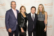 John Molner, Katie Couric, Michael J. Fox and Tracy Pollan on the red carpet of A Funny Thing Happened On The Way To Cure Parkinson's benefitting The Michael J. Fox Foundation at the Hilton New York on November 10, 2018.