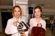 Kelly Framel (L) and Erin Framel attend Furla X the Glamourai at Bloomingdale's 59th Street Store on June 12, 2014 in New York City.