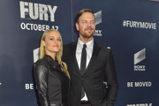 Levin Rambin and Jim Parrack pose for photographers on the red carpet during the 'The Fury' Washington D.C. premiere at The Newseum on October 15, 2014 in Washington, DC.