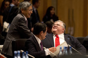 Japan's Central Bank Governor Haruhiko Kuroda (L) greets his Mexican counterpart Agustin Carstens as Japan's Minister of Finance Taro Aso (C) watches on during the opening session of the the G20 Finance Ministers and Central Bank Governors round table meeting on February 22, 2014 in Sydney, Australia. This event is the first major G20 meeting under Australia's presidency in 2014.