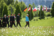 (From L to R) Japanese Prime Minister Shinzo Abe, President of the European Commission Jean-Claude Juncker, President of the European Council Donald Tusk, French President Francois Hollande, British Prime Minister David Cameron, U.S. President Barack Obama and German Chancellor Angela Merkel arrive for the group photo at the summit of G7 nations at Schloss Elmau on June 7, 2015 near Garmisch-Partenkirchen, Germany. In the course of the two-day summit G7 leaders are scheduled to discuss global economic and security issues, as well as pressing global health-related issues, including antibiotics-resistant bacteria and Ebola. Several thousand protesters have announced they will seek to march towards Schloss Elmau and at least 17,000 police are on hand to provide security.