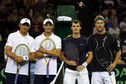 Bob and Mike Bryan of the United States pose alongside Jamie Murray and Dominic Inglot of The Aegon GB Davis Cup Team during Day 2 of the Davis Cup match between GB and USA at Emirates Arena on March 7, 2015 in Glasgow, Scotland.