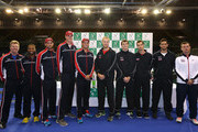 (L-R) Captain of the United States Jim Courier, Donald Young, Mike Bryan, John Isner and Bob Bryan of the United States pose along with Dominic Inglot, Jamie Murray, Andy Murray, James Ward and Captain of The Aegon GB Davis Cup Team Leon Smith ahead of the Davis Cup match between GB and USA at Emirates Arena on March 5, 2015 in Glasgow, Scotland.