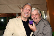 Actor Robert Morse (R) and Founder and Chairman at Michael Todd Lewis Hendler attend the GBK Productions Luxury Lounge honoring the best in TV held at LErmitage on August 23, 2014 in Beverly Hills, California.