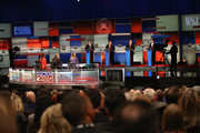 Presidential candidates Rick Santorum (L-R, on stage), New Jersey Governor Chris Christie, Mike Huckabee, and Louisiana Governor Bobby Jindal take part in the Republican Presidential Debate sponsored by Fox Business and the Wall Street Journal at the Milwaukee Theatre November 10, 2015 in Milwaukee, Wisconsin. The fourth Republican debate is held in two parts, one main debate for the top eight candidates, and another for four other candidates lower in the current polls.
