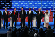 Republican presidential candidates (L-R) Rick Santorum, Rep. Ron Paul, Texas Gov. Rick Perry, Mitt Romney, Herman Cain, Newt Gingrich, Rep. Michele Bachmann, and Jon Huntsman are introduced prior to a debate at ConstitutionHall November 22, 2011 in Washington, DC. The debate, hosted by CNN andÊin partnership with the Heritage Foundation and the American Enterprise Institute, was expected to focus primarily on national security, foreign policy and the economy.