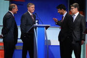 Republican presidential candidates (L-R) Jim Gilmore, U.S. Sen. Lindsey Graham (R-SC), Louisiana Gov. Bobby Jindal and Rick Perry visit during a commerical break from a presidential pre-debate forum hosted by FOX News and Facebook at the Quicken Loans Arena August 6, 2015 in Cleveland, Ohio. Seven GOP candidates were selected to participate in the forum based on their rank in an average of the five most recent national political polls.