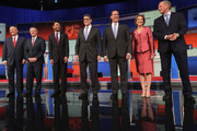 Republican presidential candidates (L-R) Jim Gilmore, Sen. Lindsey Graham (R-SC), Louisiana Gov. Bobby Jindal, Rick Perry, Rick Santorum, Carly Fiorina and George Pataki pose for a photograph at the beginning of a presidential forum hosted by FOX News and Facebook at the Quicken Loans Arena August 6, 2015 in Cleveland, Ohio. The seven GOP candidates were selected to participate in the forum based on their rank in an average of the five most recent national political polls.