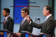 Republican presidential candidates (L-R) Louisiana Gov. Bobby Jindal, Rick Perry and Rick Santorum participate in a presidential pre-debate forum hosted by FOX News and Facebook at the Quicken Loans Arena August 6, 2015 in Cleveland, Ohio. Seven GOP candidates were selected to participate in the forum based on their rank in an average of the five most recent national political polls.