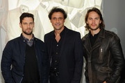 (L-R) Justin Bartha, Francis Pierrel and Taylor Kitsch attend GQ X Lacoste Celebrate Sport pop-up shop opening in NYC hosted by Paul Wesley on October 23, 2014 in New York City.