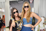 Ella Marciano and Gigi Hadid attend the GUESS Hotel pool party at Viceroy Palm Springs on April 13, 2013 in Palm Springs, California.